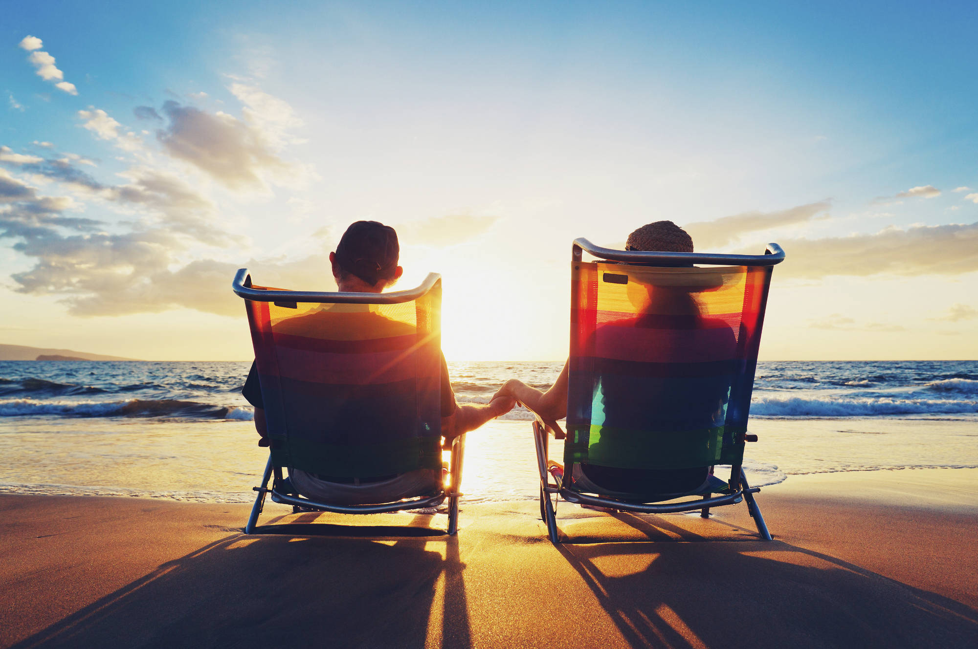 Happy retired couple enjoying the sunset